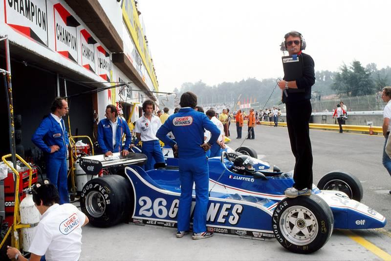 Ligier designer Gerard Ducarouge stands on the Gotti wheeled Ligier JS11/15 of Jacques Laffite.