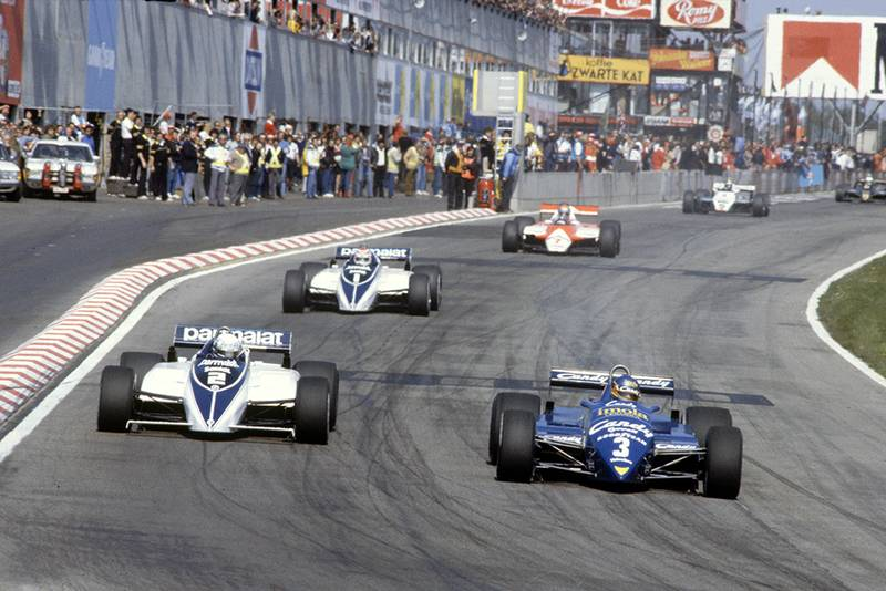 Michele Alboret in his Tyrrell 011-Ford leads Riccardo Patrese (Brabham BT50-BMW), Nelson Piquet (Brabham BT50-BMW), John Watson (McLaren MP4/1B-Ford), Derek Daly (Williams FW08-Ford) and Elio de Angelis (Lotus 91-Ford).