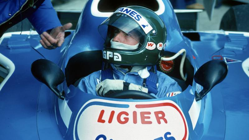 Jacques Laffite in the pis with his helmet on during the 1976 Spanish Grand Prix weekend at Jarama