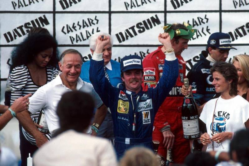 Keke Rosberg is crowned World Champion after finishing fifth in the final race of the season. To his right are John Watson and Michele Alboreto who finished second and first respectively. Diana Ross (far left) presented the trophies.