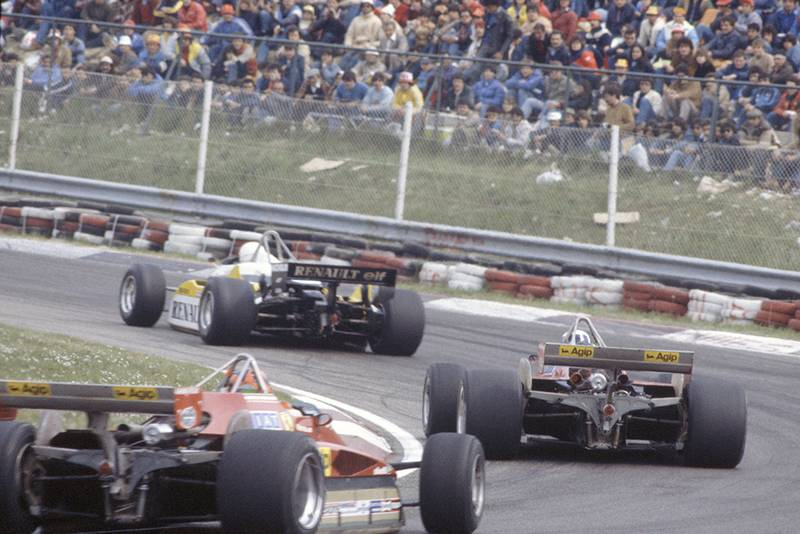 Rene Arnoux (Renault RE30B) leads Didier Pironi and Gilles Villeneuve (both Ferrari 126C2).