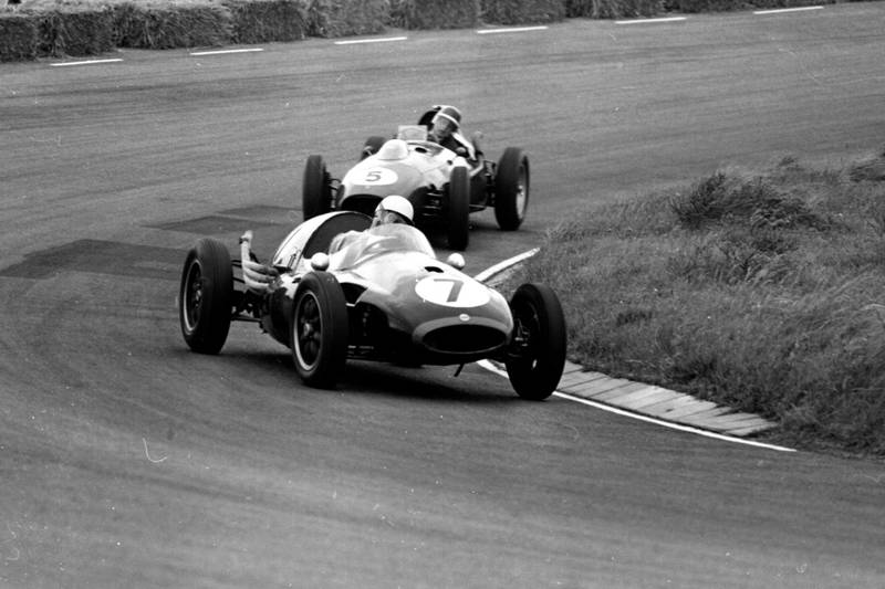 Roy Salvadori driving a Cooper T45 Climax, leads Mike Hawthorn in his Ferrari 246.