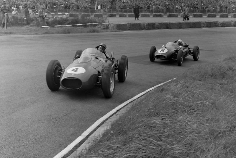 Peter Collins driving a Ferrari 246 ahead of Jack Brabham's Cooper T45 Climax.
