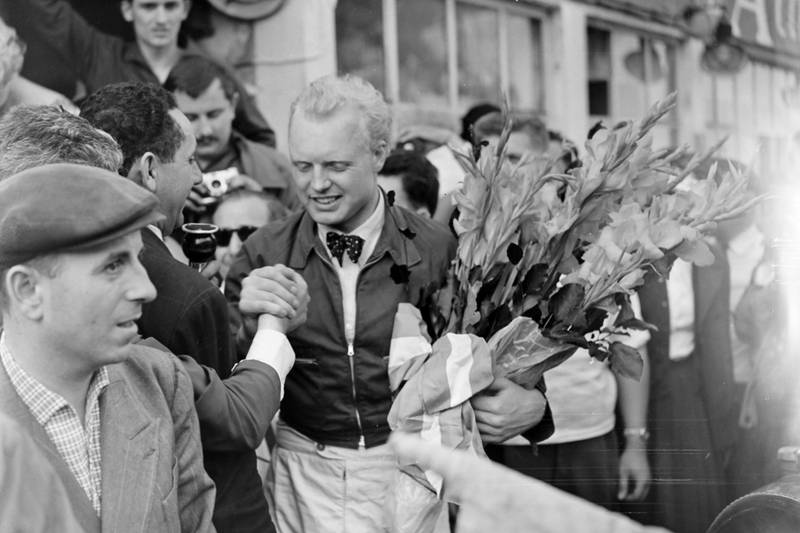 Mike Hawthorn celebrating his victory at the French GP.