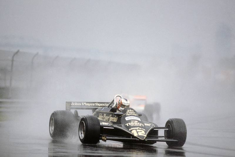 Nigel Mansell in a Lotus 87-Ford Cosworth, he later retired.