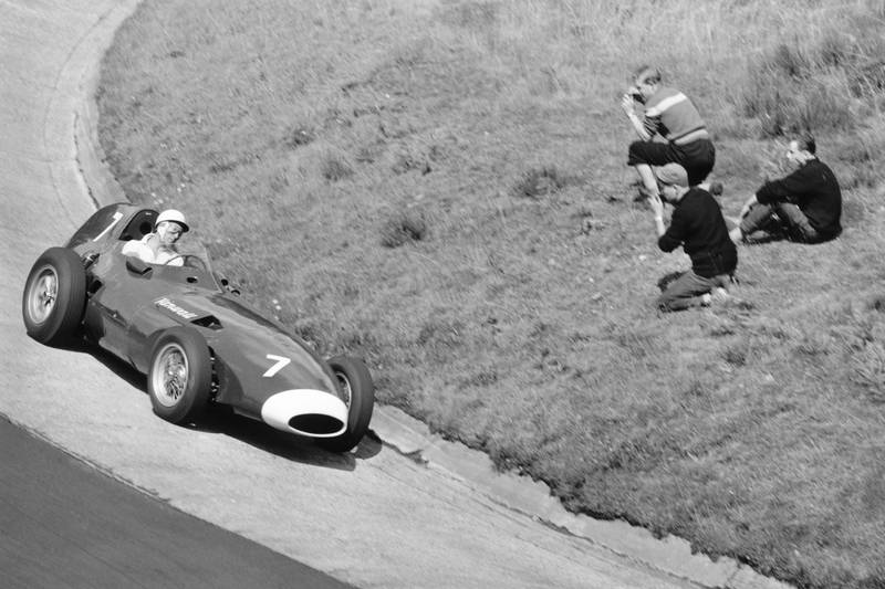 Stirling Moss takes his Vanwall around theKarussel.