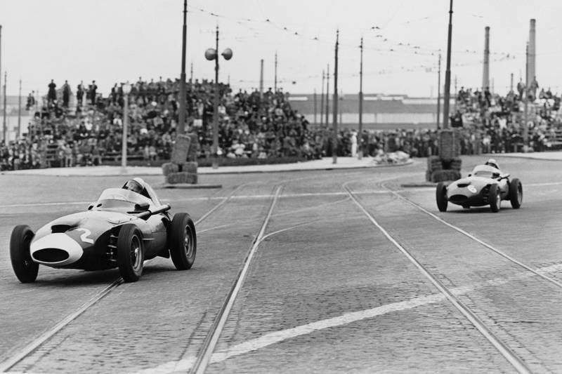 Stirling Moss in a Vanwall VW10 leads Stuart Lewis-Evans in his Vanwall VW6.