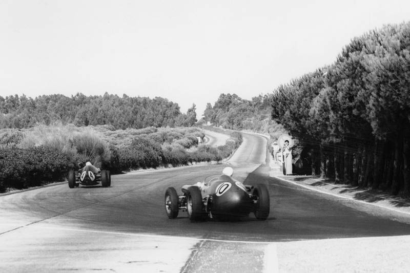Roy Salvadori in his Aston Martin DBR4/250 chases Stirling Moss in his Cooper T51-Climax