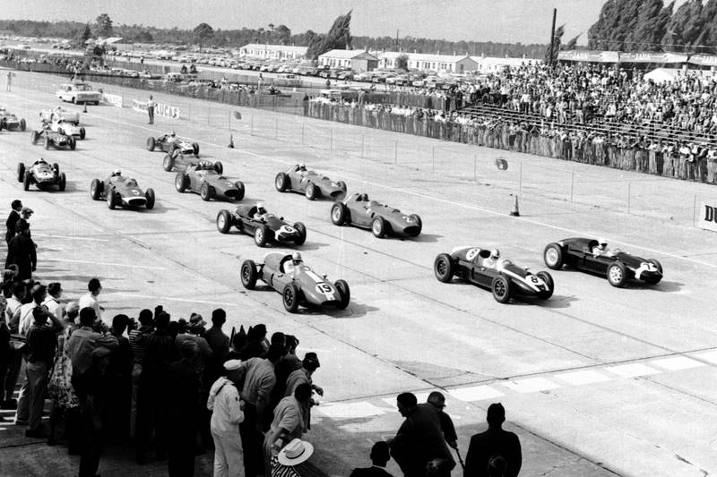 Stirling Moss, Jack Brabham and Harry Schell lead at the start of the race.