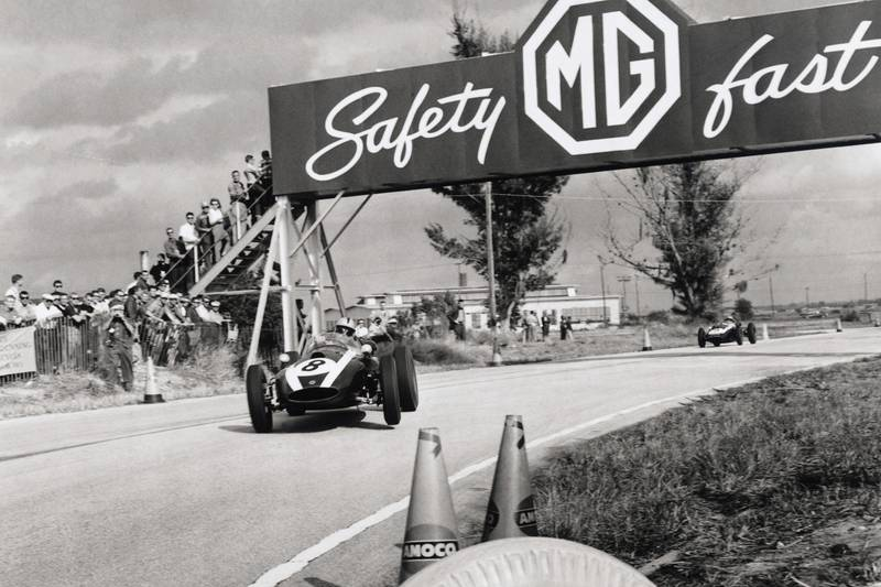 Jack Brabham in his Cooper T51-Climax leads Bruce McLaren also in a Cooper T45-Climax.