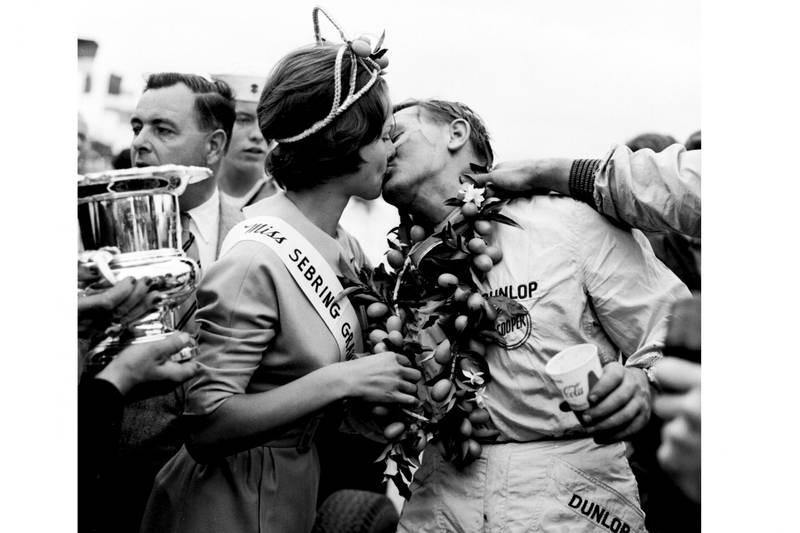 Race winner Bruce McLaren gets a kiss abd his garland from Miss Sebring Grand Prix.