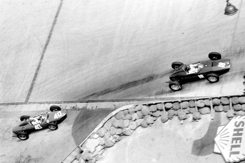 Graham Hill in a BRM P48/57-Climax leads Wolfgang von Trips driving a Ferrari Dino 156.