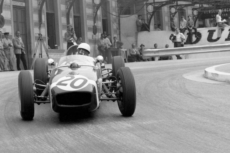 Stirling Moss pushing his Lotus 18-Climax.