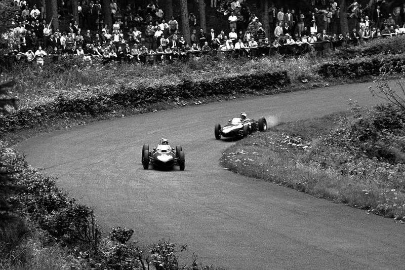 Wolfgang von Trips leads Phil Hill both in Ferrari 156s.