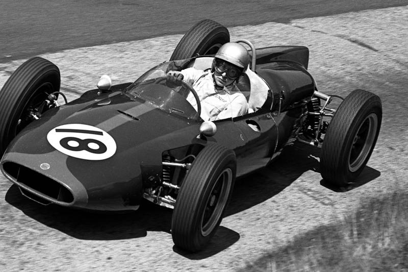 John Surtees driving a Cooper T53 at the Karussel.