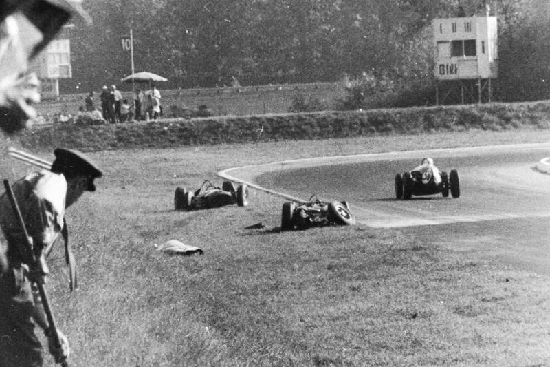 The aftermath of the accident between Wolfgang von Trips (Ferrari Dino 156) and Jim Clark (Lotus 21-Climax). Von Trips suffered fatal injuries in the accident.