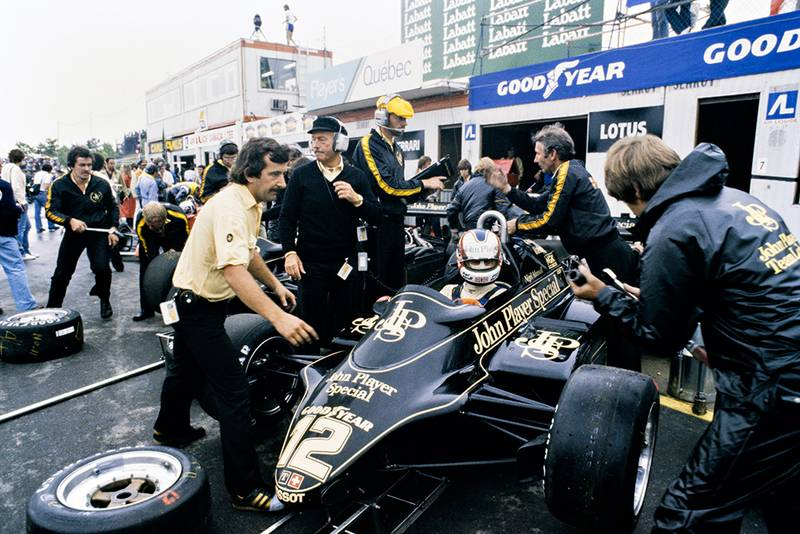 Nigel Mansell's Lotus 91-Ford in the pit lane.