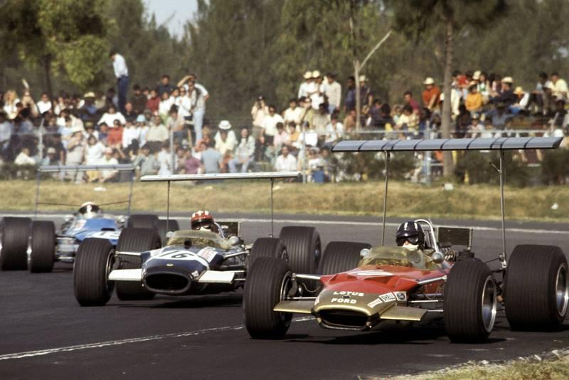 Graham Hill (Lotus) leads Jo Siffert (Lotus) and Jackie Stewart (Matra).