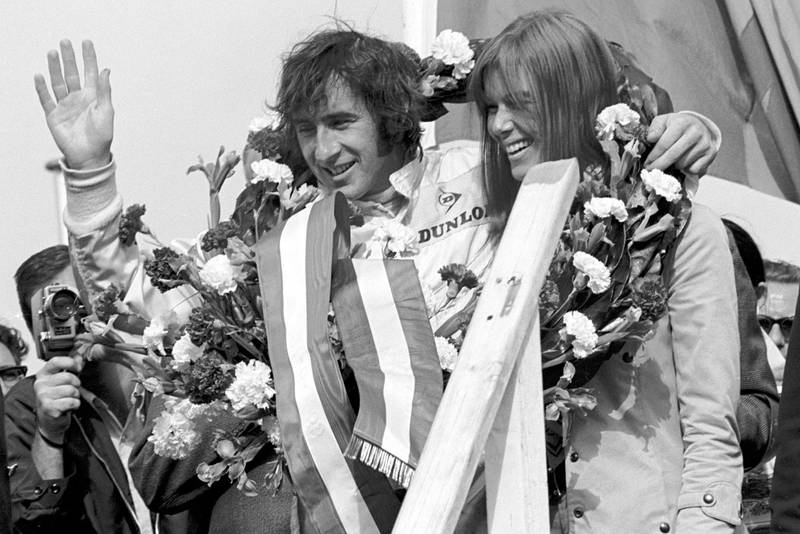 Jackie Stewart celebrates winning the 1969 Dutch Grand Prix on the podium