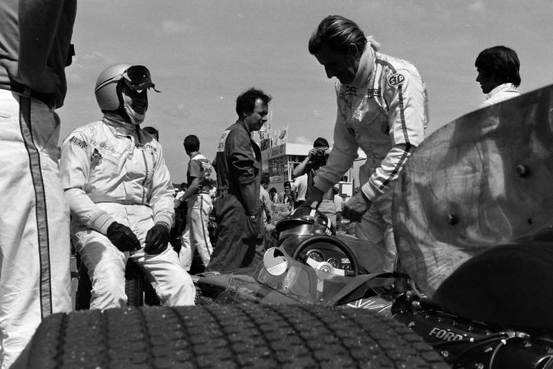 Graham Hill stands by his car before the 1969 French Grand Prix.