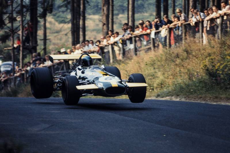 Jacky Ickx's car takes off as he goes through the flugplatz