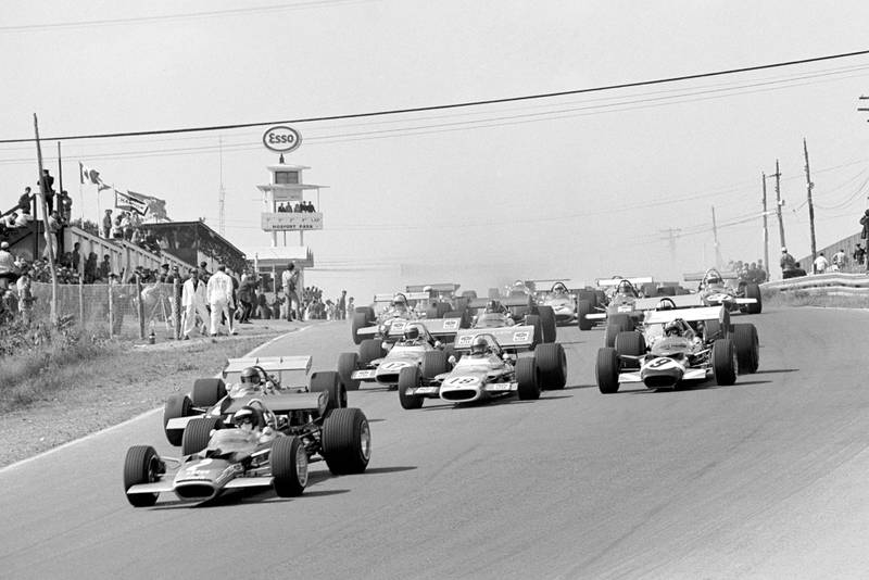 Cars head down the hill at the start of the 1969 Canadian Grand Prix