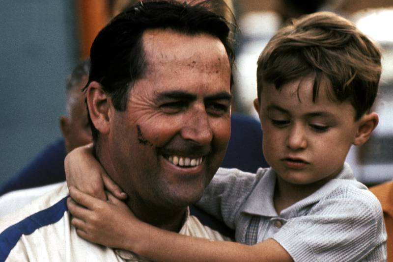 Jack Brabham holds one of his children after winning the 1970 South African Grand Prix