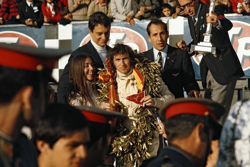 Jackie Stewart celebrates his 1970 Spanish Grand Prix victory on the podium