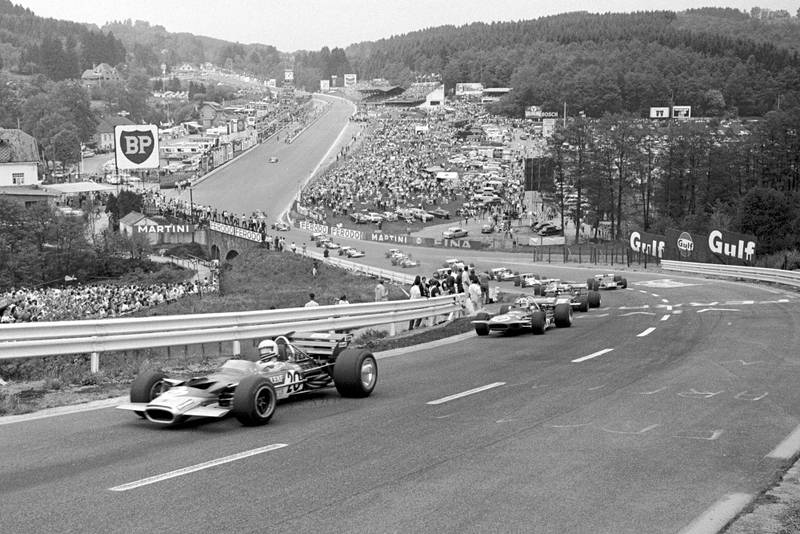 The pack make its way up Eau Rouge and Raidillon at the 1970 Belgian Grand Prix