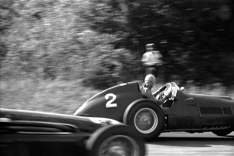 Between the two 'Porfido' corners at Monza (now the Parabolica) Alberto Ascari looks back over his shoulder from his Ferrari 375/F1 and directly into Klemantaski?s camera during the Italian Grand Prix at Monza, 16th September 1951. (Photo by Klemantaski Collection/Getty Images)