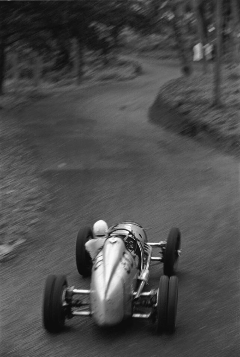 Prescott Hill-Climb, May 14, 1939. George Abecassis roars up into the Esses in his two-liter Alta. In this photo one can see the twisting road ahead and the slide of the car caught by the driver. Much is blurred by motion, but the steeringwheel is in perfect focus. (Photo by Klemantaski Collection/Getty Images)