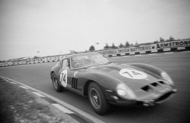 John Surtees, in the Bowmaker Ferrari 250GTO, driving through Paddock Bend during a practise session for the Peco Trophy Race, Brands Hatch, 5th August 1962. (Photo by Klemantaski Collection/Getty Images)
