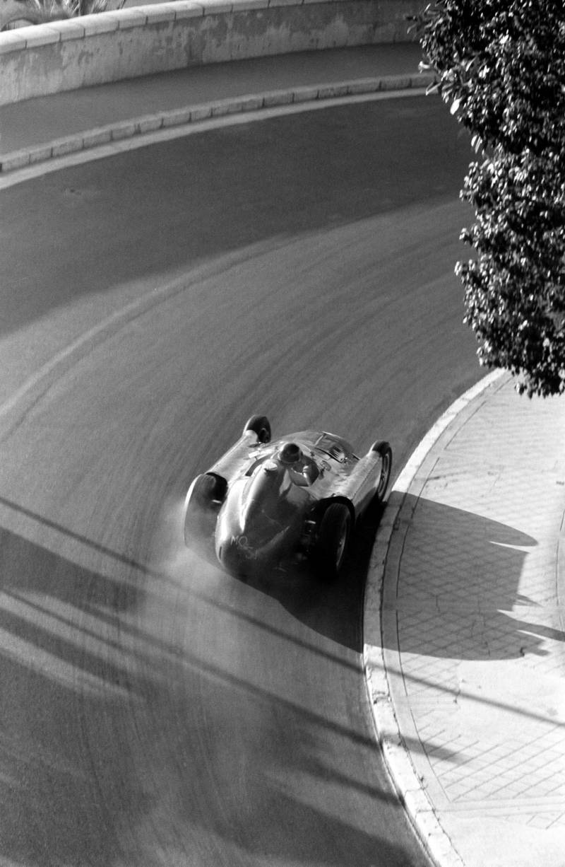 Juan Manuel Fangio of Argentina driving the #28 Scuderia Ferrari Lancia-Ferrari D50 Ferrari V8, drifts around Mirabeau during an early morning practice for the Monaco Grand Prix, Monte Carlo, 13th May 1956. (Photo by Klemantaski Collection/Getty Images)