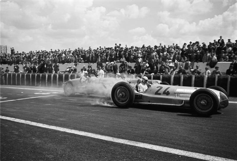 The French Grand Prix; Reims-Geuex, July 3, 1938. Rudolph Caracciola making a magnificent start in his Mercedes W154, his tire smoke almost hiding the car behind him. He finished second behind Manfred vonBrauchitsch and was followed by Hermann Lang in a Mercedes sweep. (Photo by Klemantaski Collection/Getty Images)