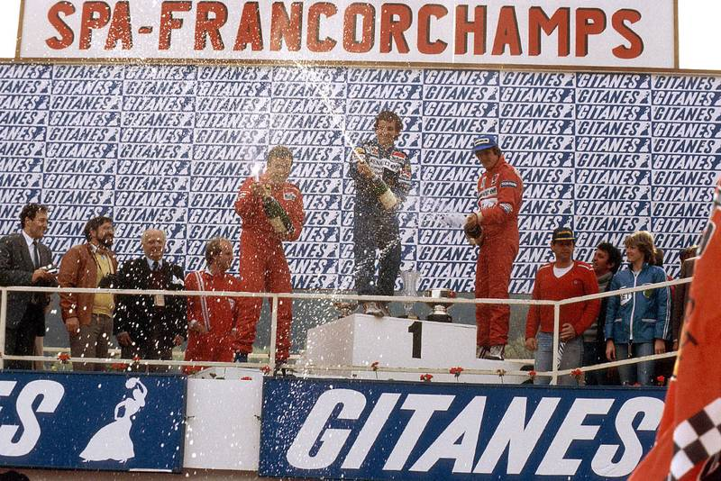 Alain Prost (1st position) Patrick Tambay (2nd position) and Eddie Cheever (3rd position) on the podium.