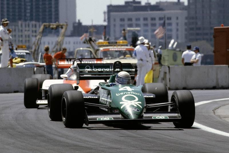 Danny Sullivan, Tyrrell 011 Ford, leads John Watson, McLaren MP4-1C Ford.