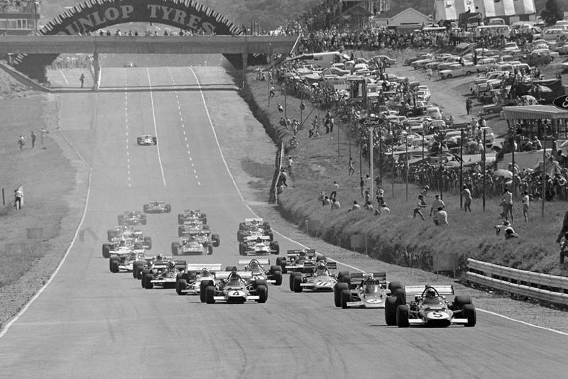 Mario Andretti's Ferrari leads the field into the first corner at the start of the 1971 South African Grand Prix.