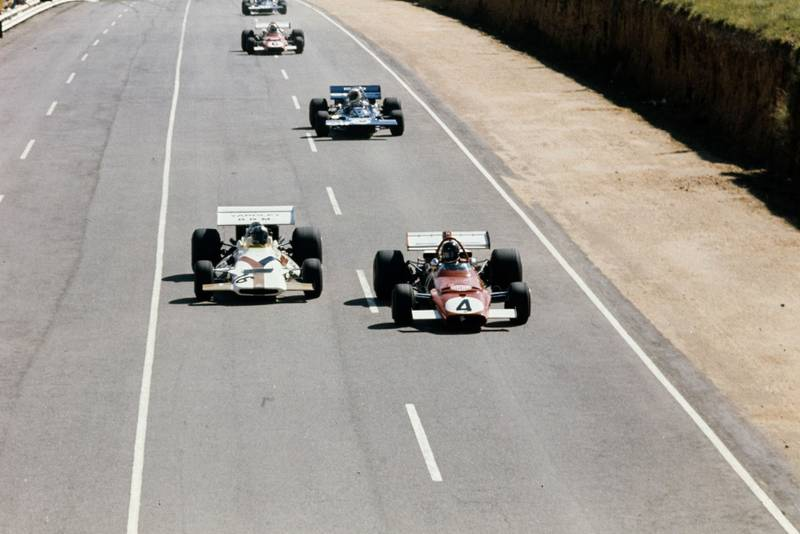 BRM's Pedro Rodriguez, left, and Ferrari's Jacky Ickx do battle on the main straight at the 1971 South Africa Grand Prix.