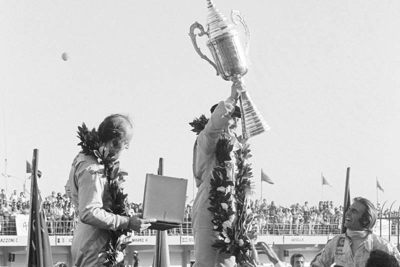 Tyrrell's Jackie Stewart celebrates winning the 1972 Argentine Grand Prix.