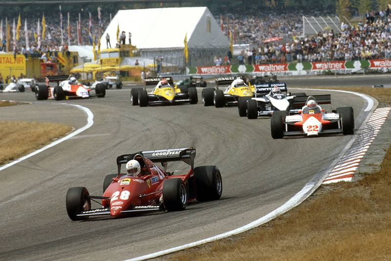 Rene Arnoux (Ferrari 126C3) leads Andrea de Cesaris (Alfa Romeo 183T), Nelson Piquet (Brabham BT52B BMW), Alain Prost and Eddie Cheever (both Renault RE40's) into the Sudkurve.