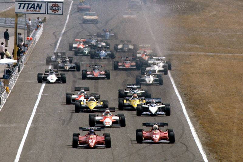 Patrick Tambay and Rene Arnoux (both Ferrari 126C3's) lead Andrea de Cesaris (Alfa Romeo 183T) and Nelson Piquet (Brabham BT52B BMW), Alain Prost and Eddie Cheever (both Renault RE40's) at the start.