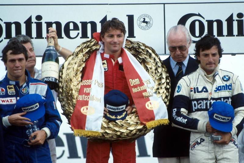 Rene Arnoux (1st place) flanked by Andrea de Cesaris, left, 2nd place and Riccardo Patrese, right, 3rd place.