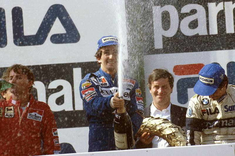 Alain Prost, 1st position, Rene Arnoux, 2nd position and Nelson Piquet, 3rd position on the podium.