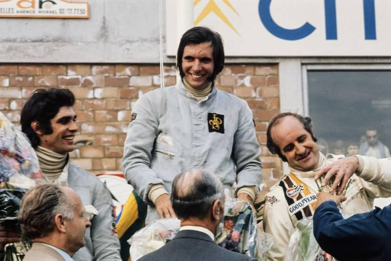 Emerson Fittipaldi celebrates his 1972 Belgian grand Prix victory on the podium.