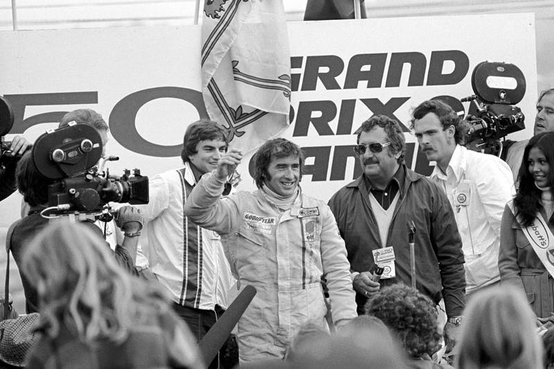 Jackie Stewart celebrates winning the 1972 Canadian Grand Prix for Tyrrell on the podium.