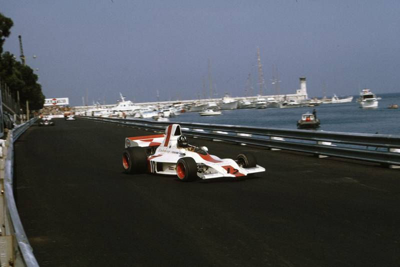 Graham Hill's Embassy Racing Shadow passes the harbour at the 1973 Monaco Grand Prix.