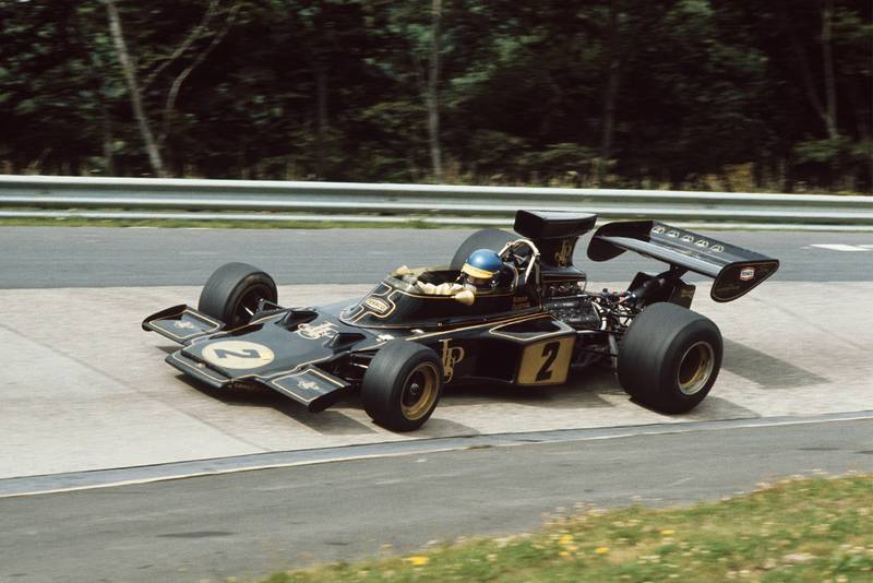 Ronnie Peterson rounding the Karussell in his Lotus at the 1973 German Grand Prix.