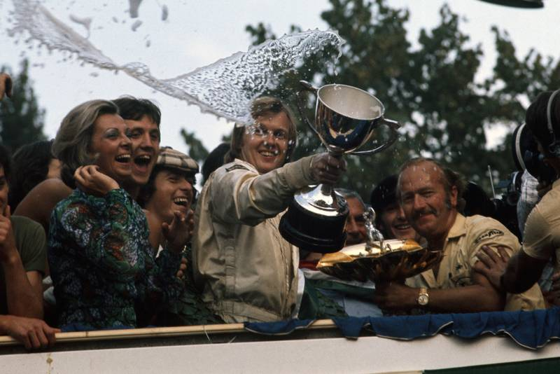 Ronnie Peterson celebrates on the podium after winning the 1973 Italian Grand Prix, Peterson.