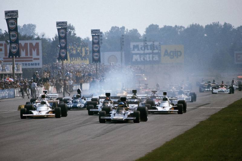 Cars smoke their tyres as the 1973 Italian grand Prix gets underway.