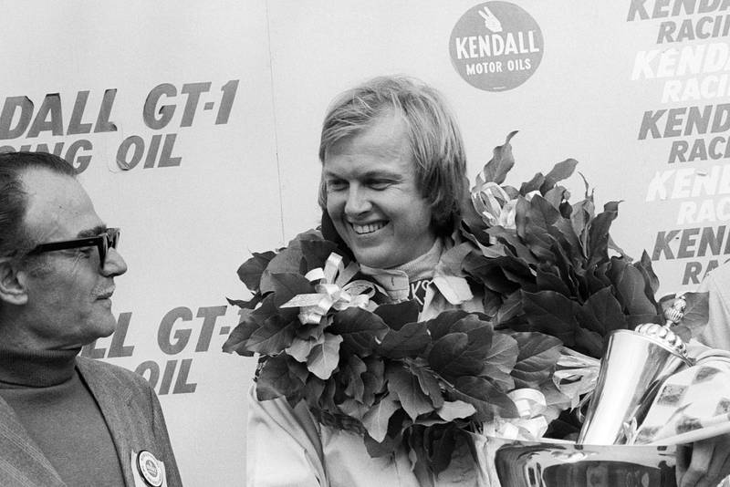 Ronnie Peterson (Lotus) smiles on the podium at the 1973 United States Grand Prix, Watkins Glen.